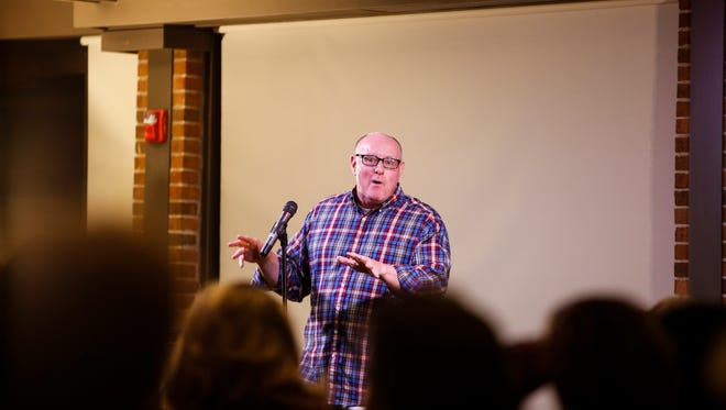 Jim DeLine of Lansing speaks about his travels in Europe and abroad September 20, 2016, during the Lansing Storytellers Project at the University Club in East Lansing.