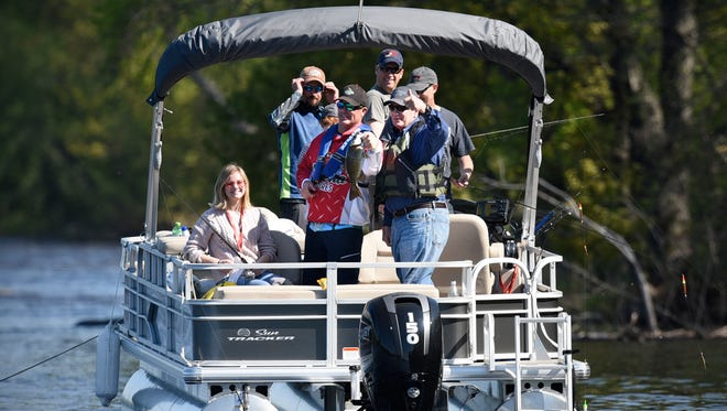 Gov. Mark Dayton gives the thumbs-up sign after catching a smallmouth bass during the 2017 Governor's Fishing Opener Saturday, May 13, on the Mississippi River in St. Cloud.