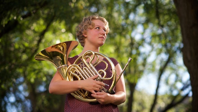Hornist Madeleine Folkerts comes to Great Falls from Washington, where she graduated from St. Olaf College.