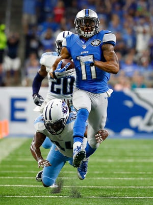 Lions receiver Marvin Jones tries to break away from Titans safety Daimion Stafford during the first half Sept. 18, 2016 in Detroit.
