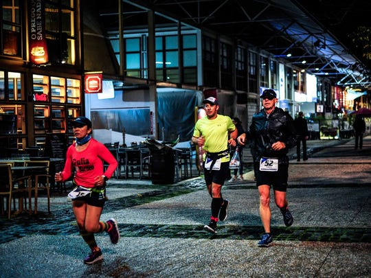 7 marathons, 7 continents, 7 days: Knoxville resident Brian Winter completed that feat this year becoming one of only several hundred runners to ever finish the World Marathon Challenge. Here he is running in Lisbon with friend Andrew Brooks.
