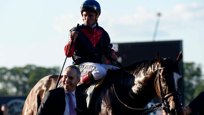 Joel Rosario aboard Tonalist reacts after winning the 2014 Belmont Stakes at Belmont Park
