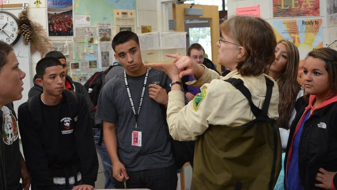 Karen Hans, a Salmon Trout Enhancement Program biologists with the Oregon Department of Fish and Wildlife talks about fish with a high school biology class in Salem.