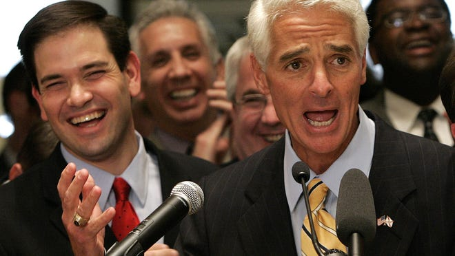 FILE- In this May 4, 2007 file photo, Florida Gov. Charlie Crist, left, and House Speaker Marco Rubio, R-Coral Gables, left, take part in closing ceremonies of the Florida Legislature, in Tallahassee, Fla. If former Florida Gov. Charlie Crist wins his old job back as a Democrat, he could be in a position to seek political revenge against two Republicans whom he once counted as friends, Jeb Bush and Sen. Marco Rubio. (AP Photo/Phil Coale, File)