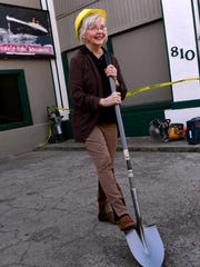 """Carolyn Walden, who founded the Discovery Center with her late husband,Tommy, holds a ceremonial shovel in the parking lot Feb. 2 The  museum is building an addition called """"The Miracle of Israel."""" The exhibit will feature artifacts and information on the creation of the modern state of Israel."""