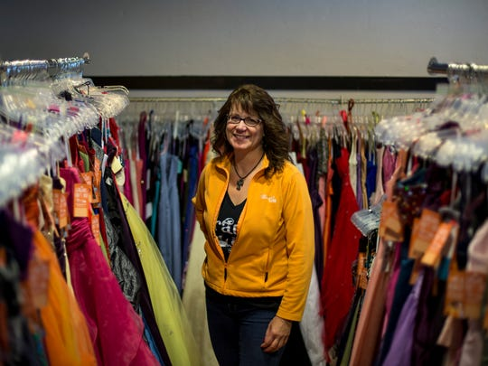 Karen Palka pictured among more than 800 prom dresses