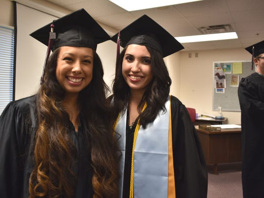 Aidee Covarrubias and Melinda Brady embrace before commencement begins. Brady was chosen to give the Charge to the Graduates - Bachelor's of Science Degrees.