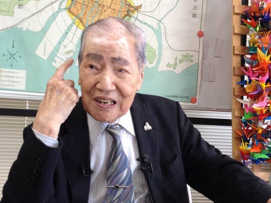 Suneo Tsuboi, 91, was about 1 mile from ground zero