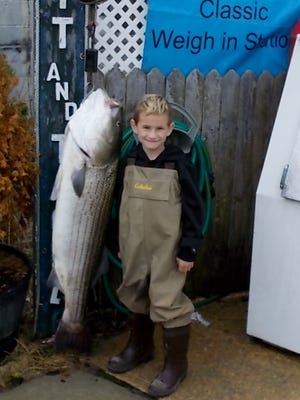 Sam Adams, 6-years old of Pitman, with the 41-pound, 5-ounce striped bass he caught during the Long Beach Surf Fishing Classic.