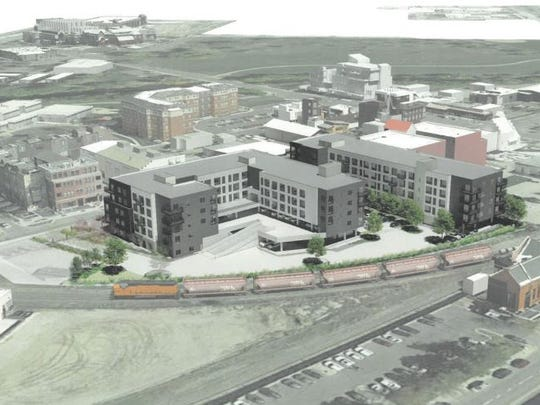 An aerial view of the housing proposed by CA Ventures for  Willow Street looks northeast, with Rodizio Grill in the foreground and the Northside Aztlan Center on the left.