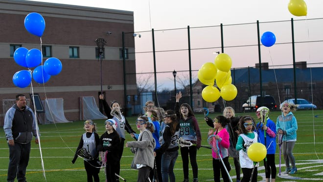 Mason students involved in Youth Lacrosse released balloons at halftime of the Mason vs. Kings Girls Lacrosse Match in honor of Maya Collins, recent Mason student who lost her battle with Pediatric Cancer, April 17, 2018.