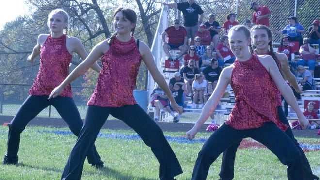 The Wellsville High School dance team performs at halftime of the homecoming football game Saturday.