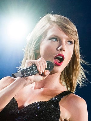 """Singer Taylor Swift performs during her """"1989"""" world tour at MetLife Stadium on Saturday, July 11, 2015, in East Rutherford, New Jersey."""