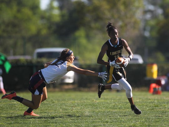 Lincoln's Kayley Farmer takes off upfield after making