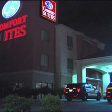 Investigators said two men used a gun to rob the Quality Suites on Southeast Military around 3 a.m.