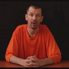 John Cantlie, a British journalist, has been identified as a captive of ISIS militants in a video posted online.