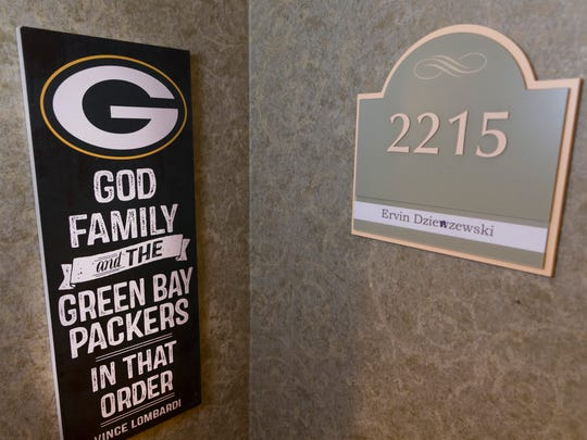 Erv Dzierzewski was a guard on the 1944 Green Bay Packers. He was cut from the team and shortly afterward joined the army. The entrance to his apartment is shown in Milwaukee.