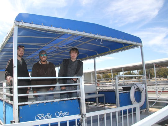 T.J. Ryan, Nico Barrera and Jay Balzano pose on the Bella Sera, which will carry guest down the Pecos River for the 2015 Christmas on the Pecos.