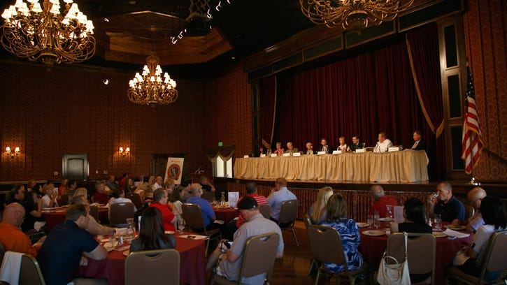 Nine local candidates for and current holders of Utah House and Senate seats sit at a table on the stage at the SunRiver Community Center and address those gathered for a board of realtors luncheon Thursday in St. George.