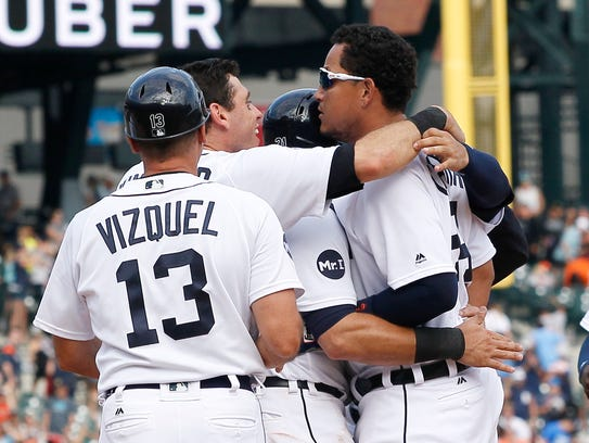 Miguel Cabrera celebrates with teammates after taking