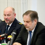 From left, Dresden, Germany, special investigator Maik Mainda and police chief  Dieter Kroll with prosecutor Erich Wenzlic on Nov. 29, 2013. A German police officer has been arrested on suspicion of killing and chopping up a man he met on the Internet.