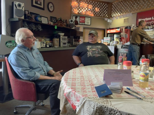 Warren Kilby (left) and Daryl Marler talk about community service the Stayton Moose Lodge is engaged in each year.