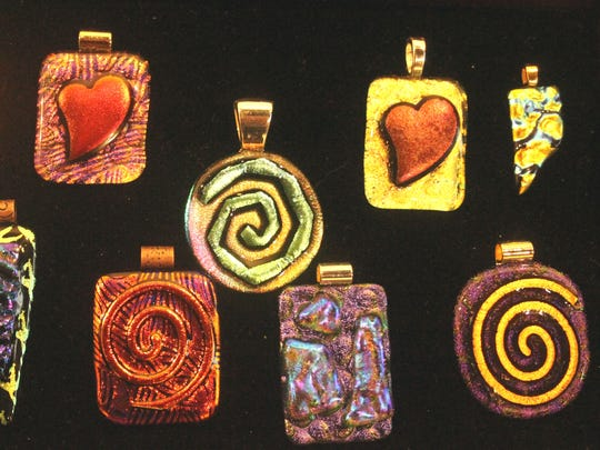 Marie Rasmussen features her dichroic glass beads in the Mesquite Fine Arts Gallery.