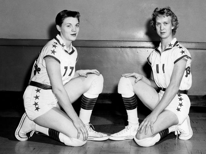 The Nashville Business College dominated the Amateur Athletic Union by winning 11 titles in its history, including eight consecutive from 1962 to 1969. Business college student Nera White, right, and a teammate pose in this undated photo.