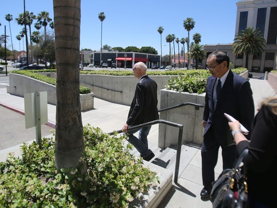 John Wessman, left, leaves the Riverside Superior Court on Friday, May 19, 2017, in Riverside after requesting the case be transferred to the Indio courthouse.