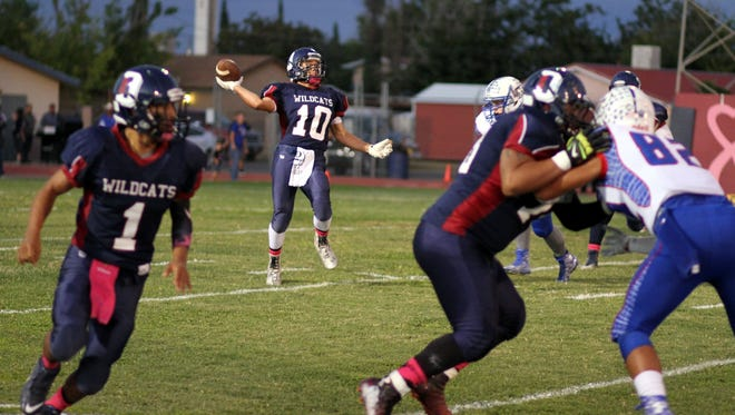 Senior Wildcats wideout Georgie Ortiz (10) pitches a long pass on the back end of a double reverse pass against Las Cruces High earlier this season in the District 3-6A. The Wildcats show they are capable of reaching deep into a bag of tricks to try and manufacture a victory.