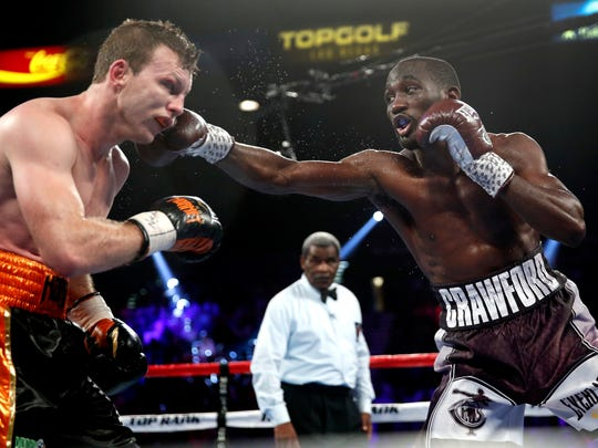 Terence Crawford, right, lands a punch on Jeff Horn, of Australia, in a welterweight title boxing match Saturday, June 9, 2018, in Las Vegas.