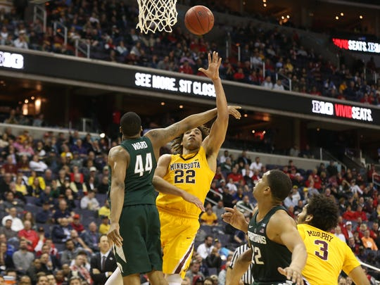 Gophers center Reggie Lynch scores two of his 16 points over MSU's Nick Ward during Friday's Big Ten tournament game in Washington.