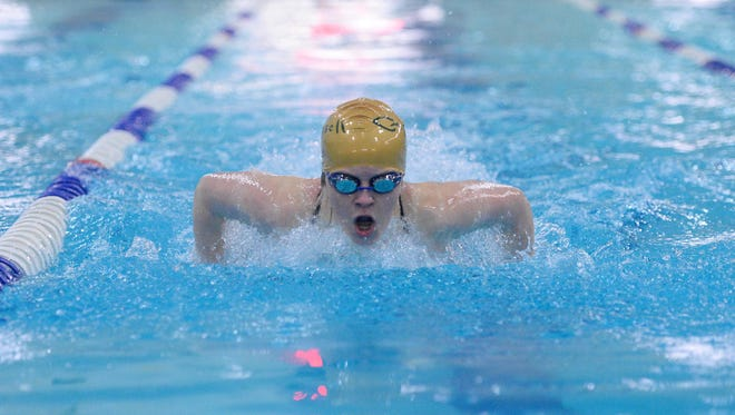 CMR's Olivia Bauman competes in the 100 butterfly.