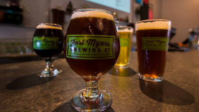 A handful of craft beers from Fort Myers Brewing Co. are displayed along the bar, which is the first craft brewery to open in Lee County. Owners Rob Whyte and Jennifer Whyte, have expanded their facility to accomodate the growth in foot traffic.