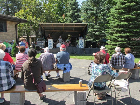 People enjoy live music at the St. Stephen Parish festival on Sept. 4, 2017 in St. Stephen.