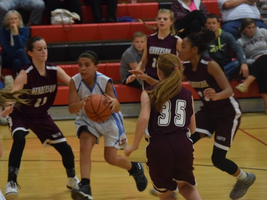 Kyla Vargeson of the seventh grade Lady Indians moves past her defender.
