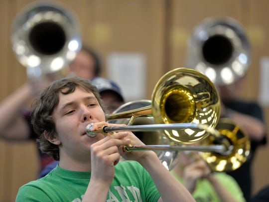 Solar Sound marching trombone player and Apollo High School senior Stephen Gruenke finishes a section of the music with a turn to the right during practice Monday at Apollo.