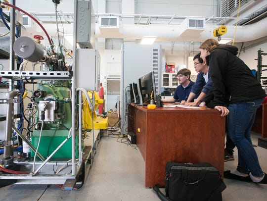 Students work in the Advanced Combustion Laboratory