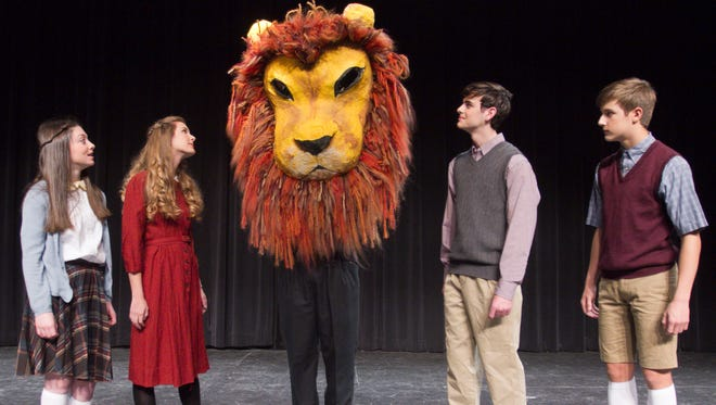 """From left, Isabella Bisio as Lucy Pevensie, Rebecca Bishop as Susan, Joshua Standley as Aslan, Steven Bonk as Peter and Nic Bishop as Edmund prepare for Howell High School's performance of """"The Lion, the Witch and the Wardrobe."""""""