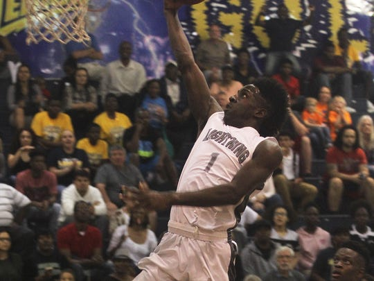 Lehigh's Quan Martin goes up for a lay up against Largo during the FHSAA 7A Region 3 Championship Friday night at the Lehigh gym.