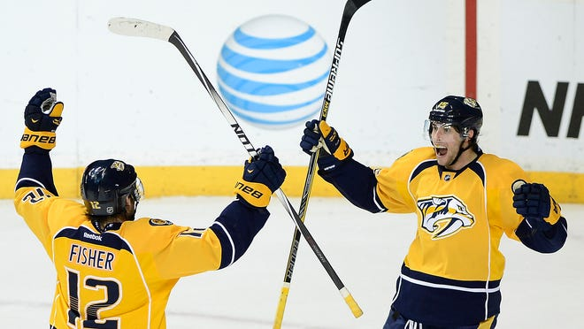 Nashville Predators center Craig Smith, right, celebrates with forward Mike Fisher (12) after Smith scored a goal in the third period in Saturday's game against the New Jersey Devils. The Predators won 3-1.