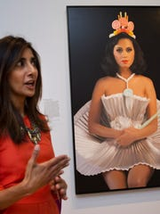 """Asma Naeem, assistant curator of prints and drawings, speaks about a painting of singer Katy Perry, by artist Will Cotton, which is part of the gallery """"Eye Pop: The Celebrity Gaze,"""" at the National Portrait Gallery, Monday May 18, 2015, in Washington."""
