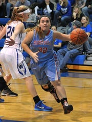 Ridgedale's Kevlynn Tilley dibbles toward the basket during their game Friday night against Wynford.