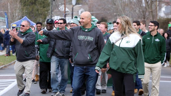 Pleasantville High School football coach Tony Becerra and his wife Kristen Becerra lead the football team in a parade honoring the team for their state championship win, Dec. 3, 2017. The team won the state class B championship on November 26th, in a 28-14 victory over Chenango Forks at the Carrier Dome in Syracuse.