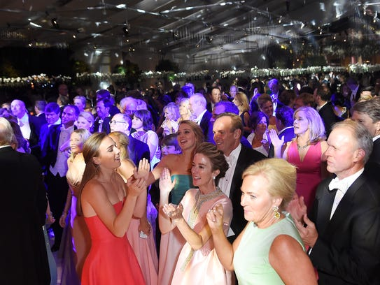 Guests dance to the music of The Sultans at Swan Ball