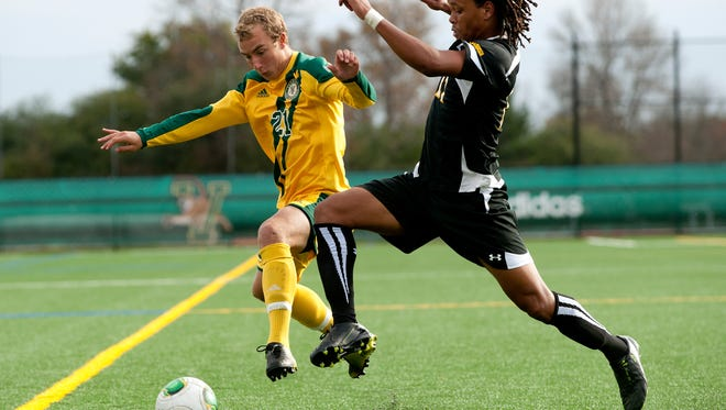 Vermont's Danny Childs (21) and UMBC's Joseph Glos (11) battle for the ball during an America East regular season game last year at Virtue Field. The two squads meet in the conference semifinals tonight at 7 p.m.