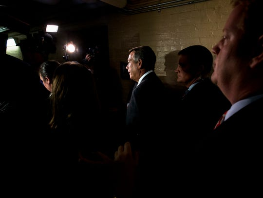 Highlighted by television camera lights, House Speaker