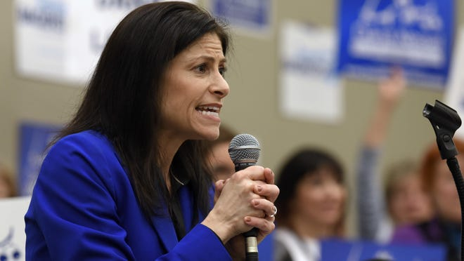 In this April 15, 2018, file photo, Dana Nessel, candidate for state attorney general, speaks to 14th District Delegates at the 2018 State Endorsement Convention of the Michigan Democratic Party at Cobo Center, in Detroit.
