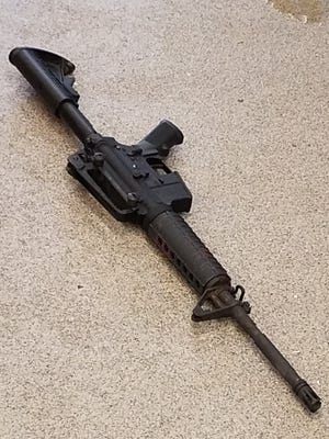 A police photograph of the gun used in a deadly Waffle House shooting on April 22.