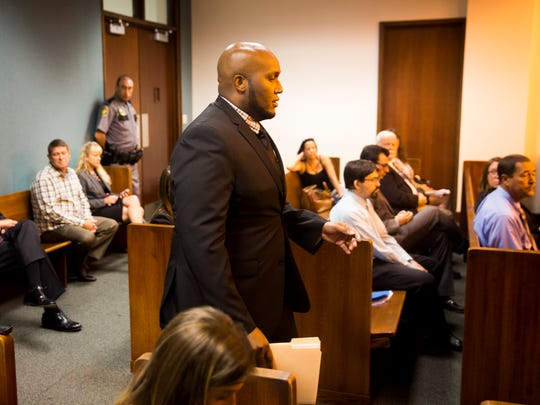 Mackindy Dieu, brother of Guerline Dieu Damas, walks forward to read a brief statement during the Spencer hearing in Mesac Damas' case Monday, Oct. 23, 2017, a the Collier County Government Center in East Naples. Damas pleaded guilty last month to six counts of first-degree murder in the killings of his wife and five children in September 2009. He could be sentenced to death Friday.